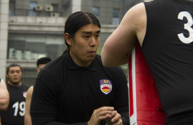 (above: CAFL executive and former NFL star Ed Wang instructs offensive linemen in Shanghai.)
