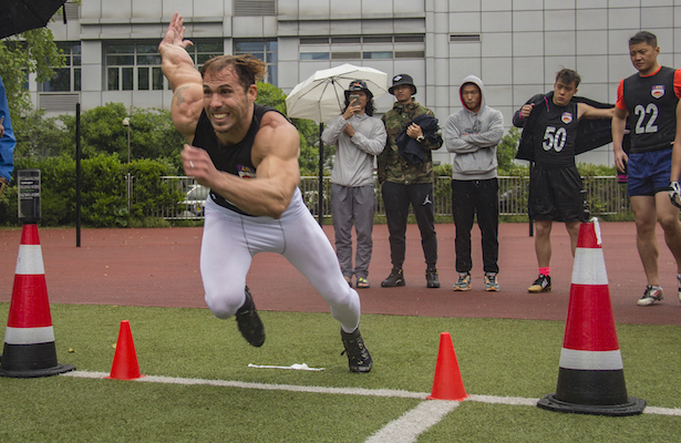 (above: a powerful linebacker fires off the line in a timed agility drill.)